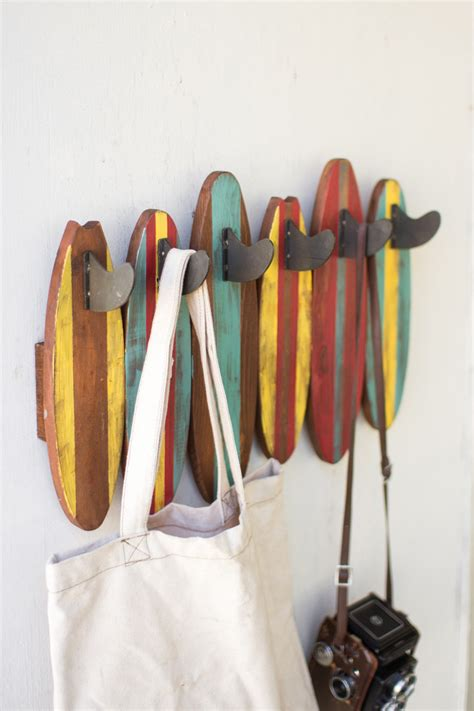 colorful wooden surfboards coat rack