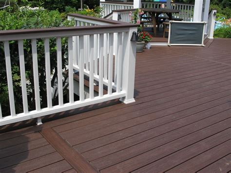 trex transcend decking lava rock bergendecks project lava rock with white railings