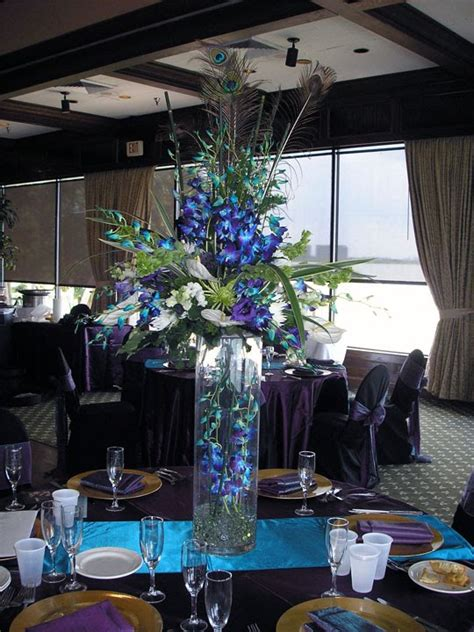 awesome centerpieces crystie s blog you can make them myself to save money and find the peacock feathers as well