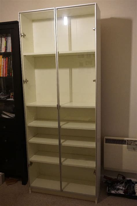 ikea bookcase billymorliden  glass doors