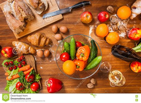 kitchen fresh foods topview of fruits and vegetables on wooden kitchen table