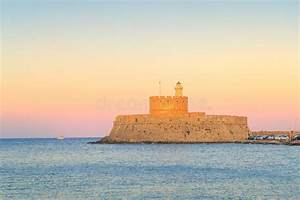 St  Nicholas Fortress And Lighthouse At Sunset  Rhodes Island  Greece Stock Photo