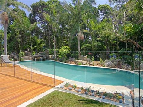 landscaped pool design using with bbq area