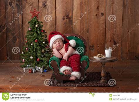 newborn baby boy wearing  santa suit stock photo image
