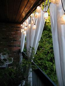 for extra balcony privacy try hanging a simple curtain With condo balcony curtains