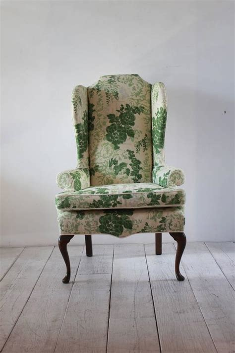vintage wing chair upholstered  green floral fabric