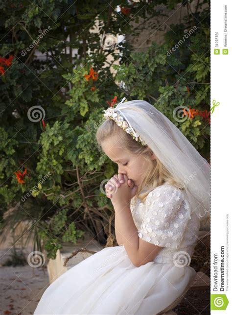 praying girl  holy communion royalty  stock