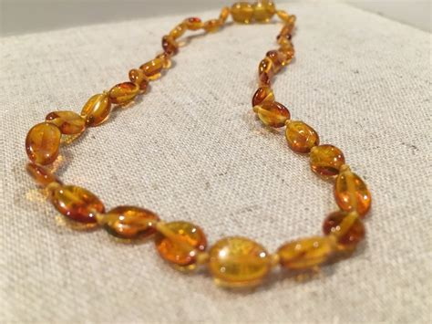 Polished Honey Bean 11 Pop Baltic Amber Necklace Teething