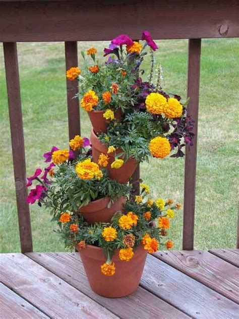 tiered planter clay pots  rod sticking  holes