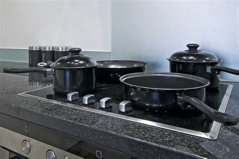 glass cookware pan pots electric stoves induction hob stove wit ring four cooktop shutterstock