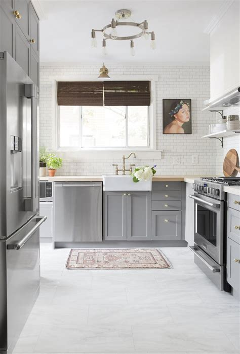 white cabinets gray floor 40 romantic and welcoming grey kitchens for your home 278 | grey cabinets with white brick walls kitchen