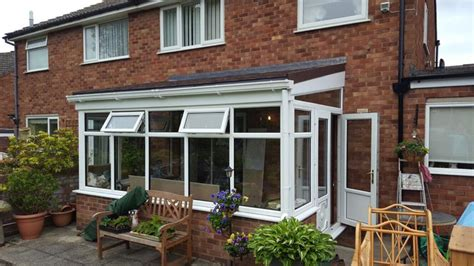 lean  conservatory  warm tiled roof   windows