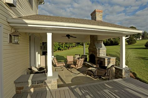 covered porch with hearth fireplace and attached