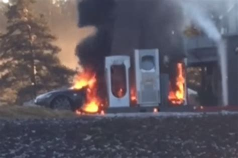 tesla model  catches fire   charging station