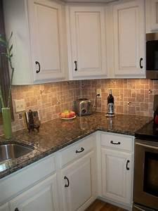 white kitchen cabinets baltic brown granite countertop ...