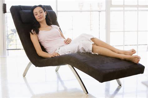 woman sitting  chair sleeping stock image image