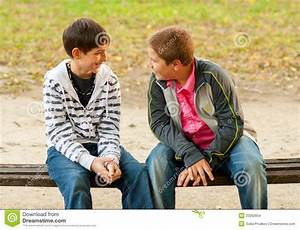 Two Teenage Friends Talking In The Park Stock Photo ...