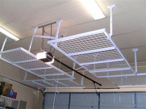 Ceiling Garage Storage Ideas by Above Garage Door Storage System Garage Storage Ideas