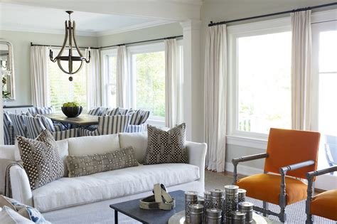 orange accent chairs transitional living room