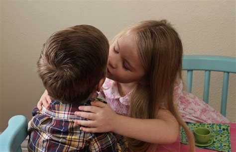 Little Girl Kissing Her Brother