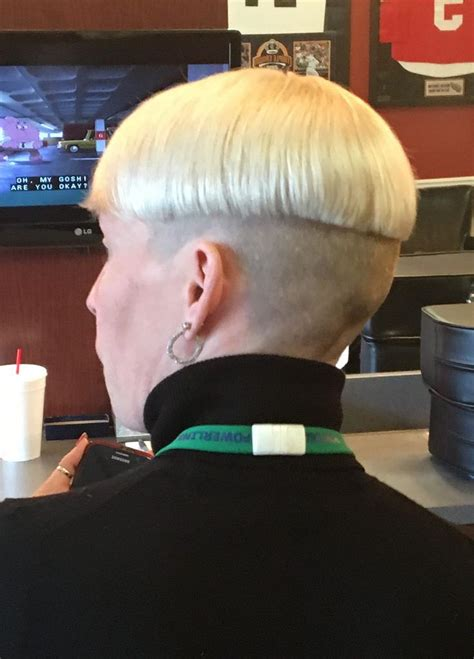 blonde  tone shaved nape bowlcut  turtleneck