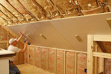 Insulating Cathedral Ceiling With Foam Board by Rigid Foam Insulation Being Hung From Sloping Ceiling