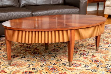 This chic coffee table conveys sophisticated simplicity with its classic design enriched by precious materials. Elegant Ethan Allen Oval Cherry Finished Coffee Table With Ribbed Apron #140388   Black Rock ...
