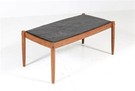 It lets you create a warm and inviting look with your favorite decor, collectibles, potted plants etc. Oak Belgium Mid-Century Modern Coffee Table with Slate Top, 1960s For Sale at 1stdibs