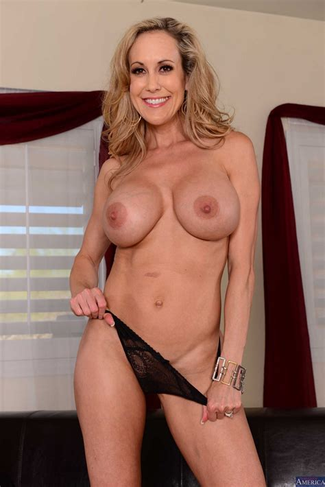 Brandi Love stripping and posing naked in front of the ...