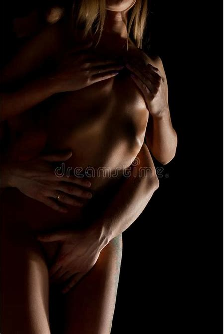 Close-Up Beautiful Young Couple, Naked Woman's Body And Man's Hands On Black Background. Stock ...
