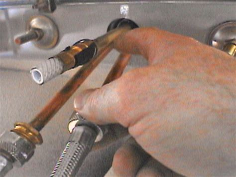 changing a kitchen faucet how to remove and replace a kitchen faucet how tos diy