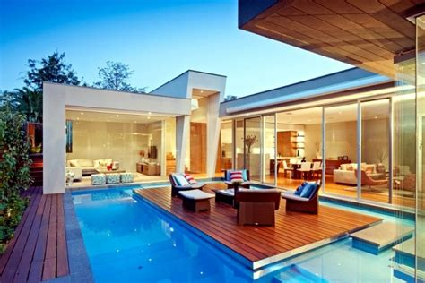 Small Modern Bathrooms Ideas by Modern House In Canterbury A Wooden Deck By The Pool