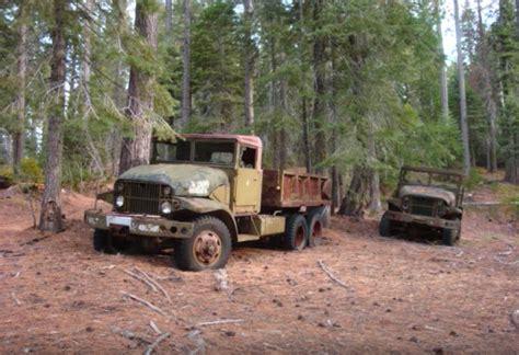secret graveyard  military trucks abandoned   woods