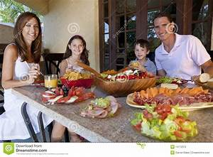 Family Eating Healthy Salad And Food Meal Stock Photo ...