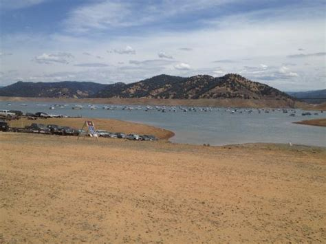 Lake Oroville Boat Launch by Boat R At Low Water Level With Flotilla Of Houseboats