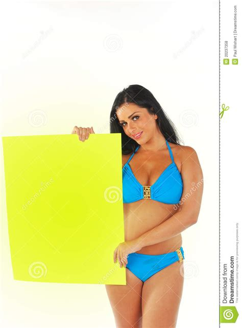 pretty girl holding white sign royalty  stock