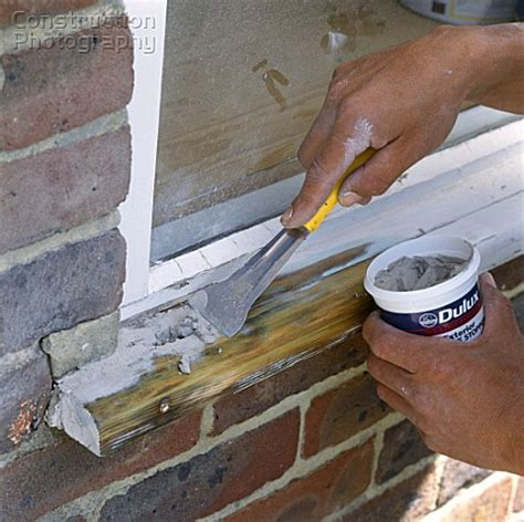 Window Sill Filler by A085 00016 Repairing A Damaged Window Applying Wood Fi