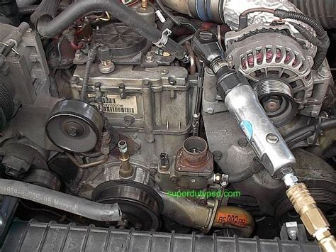 ford super duty water pump replacement procedure