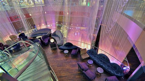 polishing the chandelier bar at the cosmo