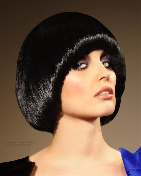 Pudding bowl or purdey hairstyle, glossy with a polished sheen