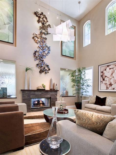 You can hang framed art, tapestries, paint it, or use wallpaper to make it pretty. Large Wall Decor for Living Room Ideas - GooDSGN