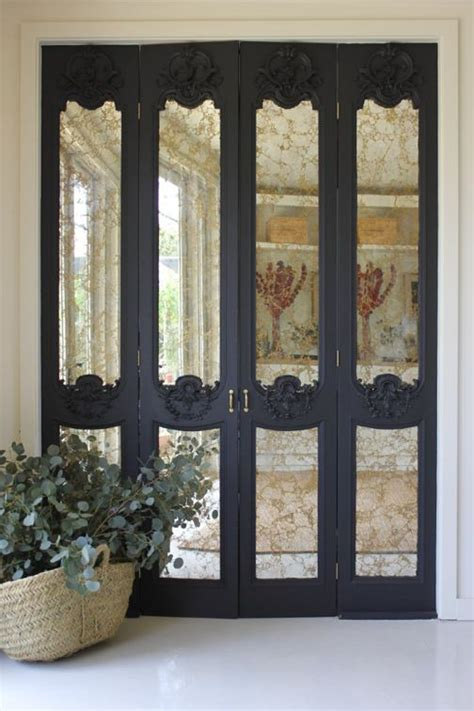 Beautiful Closet Doors by Highly Detailed Carved Wood Panels With Antique Mirror