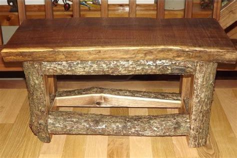 log benchcoffee table  raw legs split log