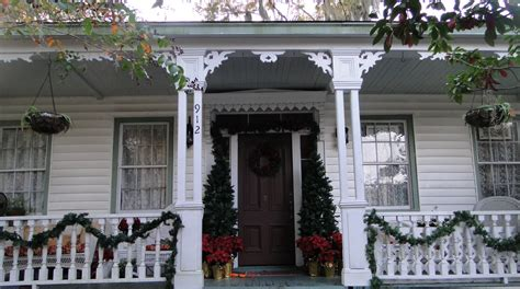 christmas decorating ideas for porch railings captivating white house applying black door with green red front porch christmas decorations
