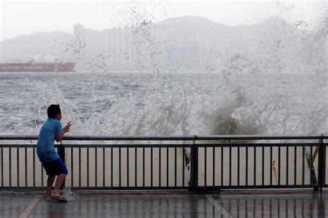 typhoon hato triggers heavy flooding  hong kong halts stock trading