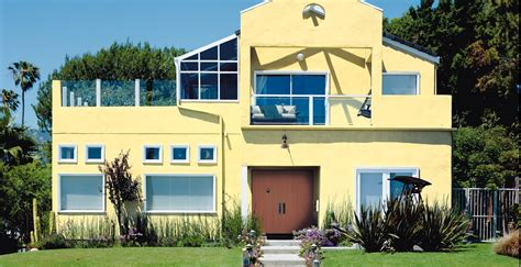 warm color exterior paint inspiration behr