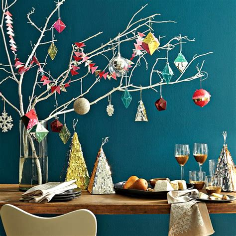 geo christmas ornaments on a tree branch decoist