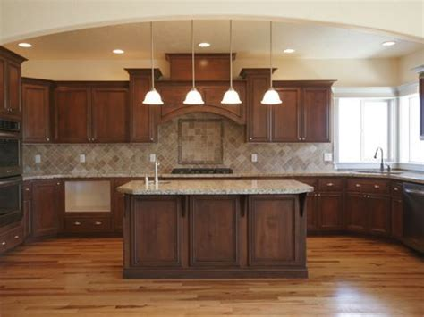 dark brown kitchen cabinets wood floor dark cabinets lighter tan or brown counter