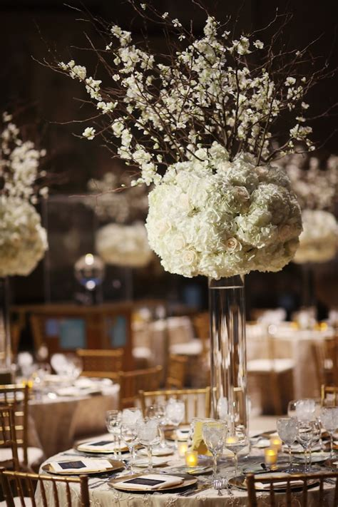 friday feature tall white  ivory floral centerpieces