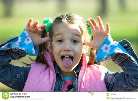 A Little Child Sticking Out Tongue Stock Image Image Of